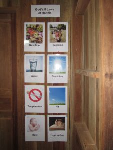 The Eight Health Laws posted on the classroom wall
